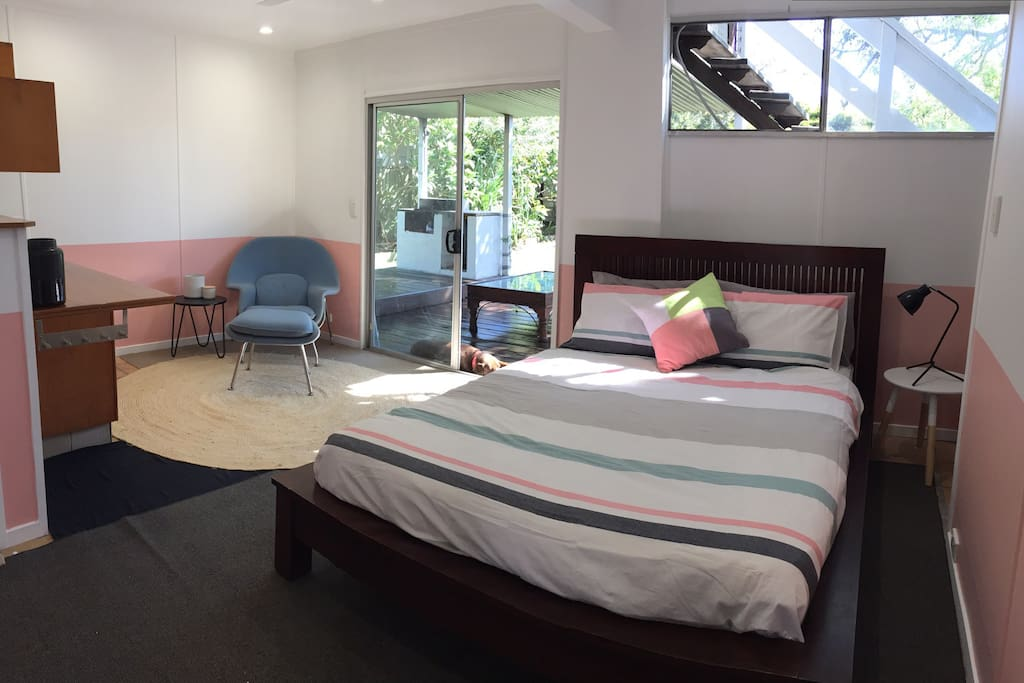 Large hotel style studio with ensuite and kitchenette, opening on to covered entertaining deck and BBQ area.