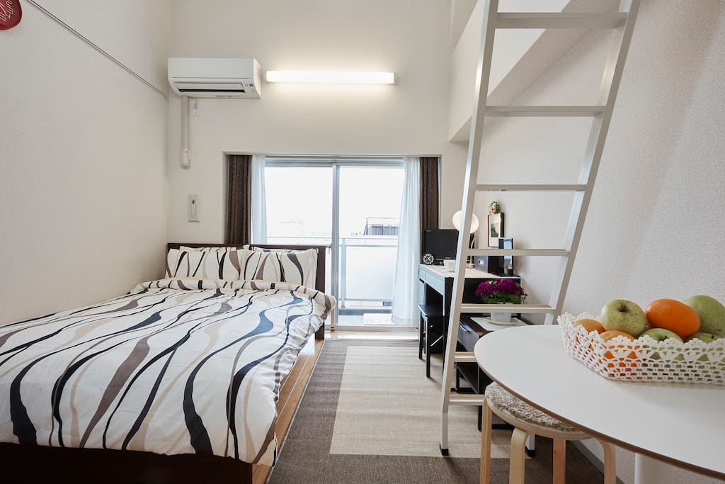 Room overall view, Spacious double bed,  round table, desk, Loft, etc.