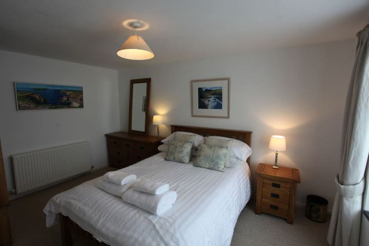 The homely and spacious double bedroom