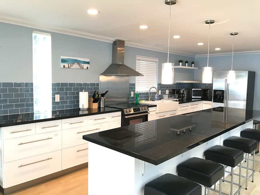 Huge kitchen with a long island, perfect for a large family.