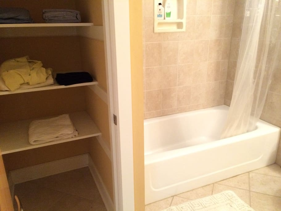 Bathroom with much storage space, towels and toiletries provided