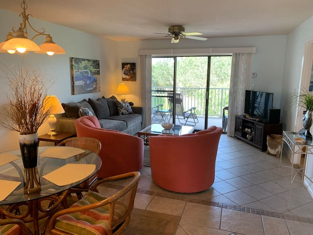 Living Room and dining area. Balcony access