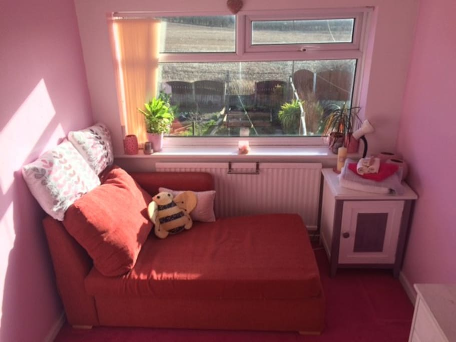 Comfortable Chaise Longue with stunning views over to Liverpool Airport ( 8 miles away) and greenbelt.