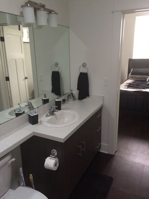 Spacious and modern bathroom with washer/dryer