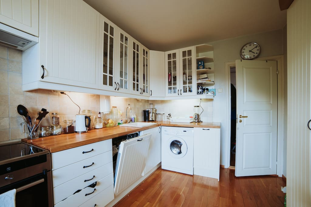 Kitchen with washer and stove