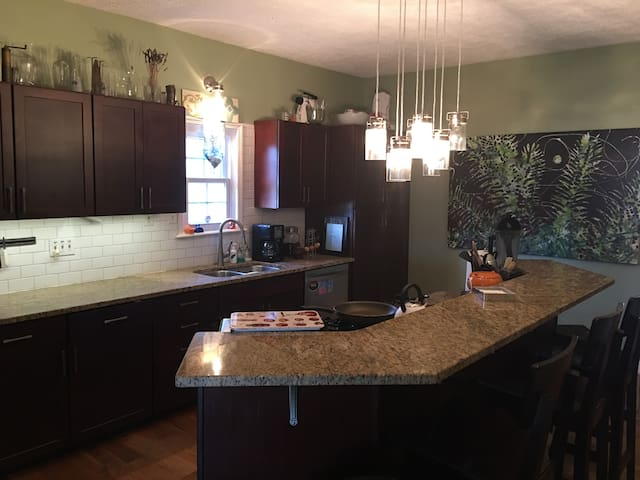 Large Island that can seat 4.  Kitchen includes coffee maker, microwave, and VitaMix!