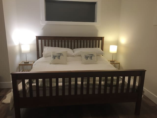 a king size bed with a memory foam mattress