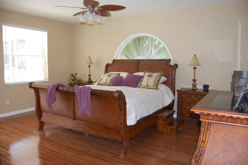 Master Bedroom with king sized bed and hardwood floors