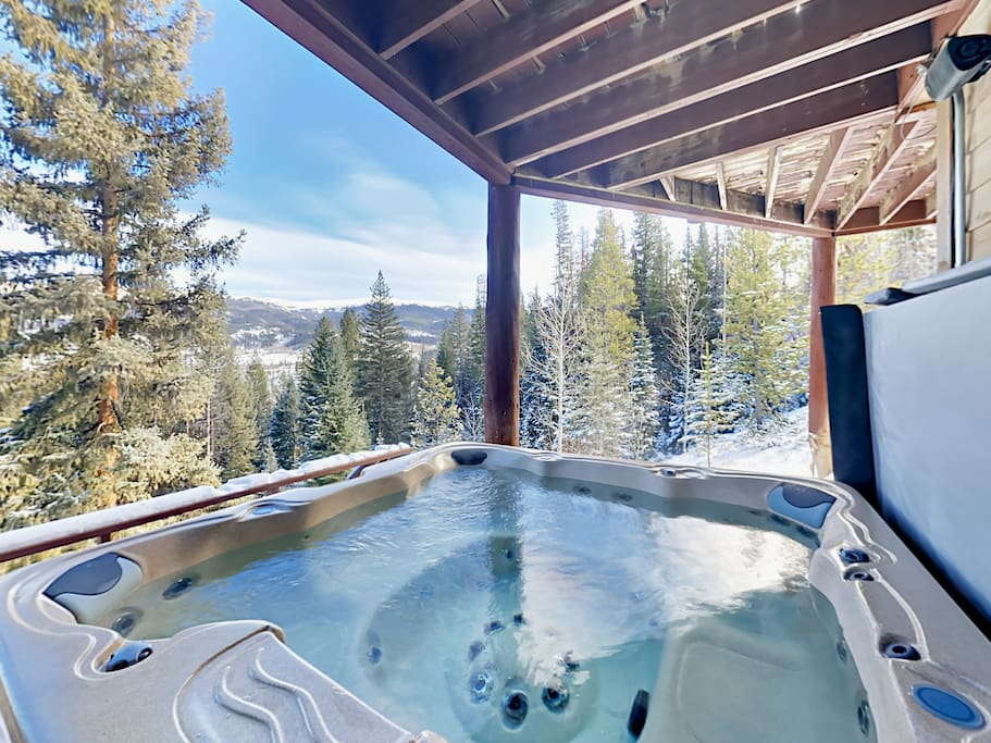 Soak in the 7-person hot tub offering expansive views of the continental divide.