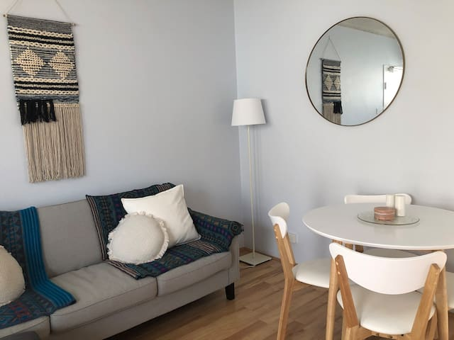 The bright living room provides a relaxed area to return to after a day at the beach! (The couch also can be converted to a double sofa bed.)