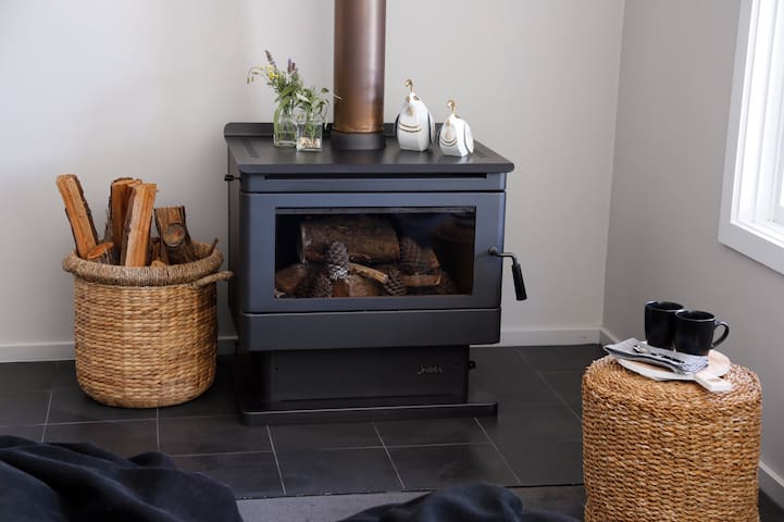 The large wood heater in the living room