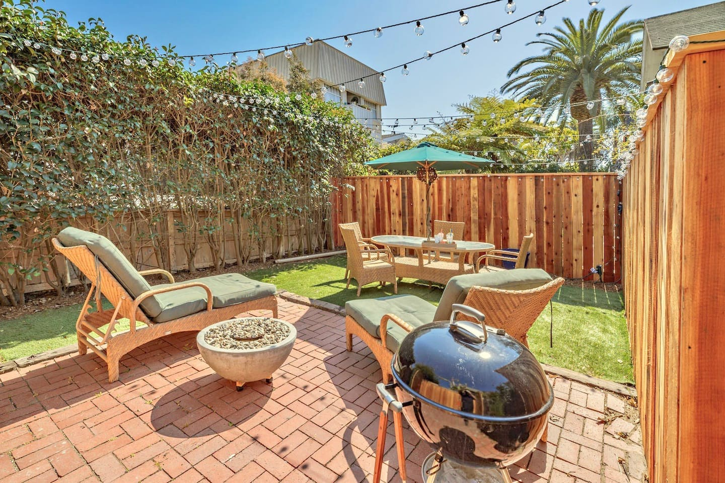 Enjoy this large private backyard like it's a second living room, for your unit only. Fire pit, and BBQ