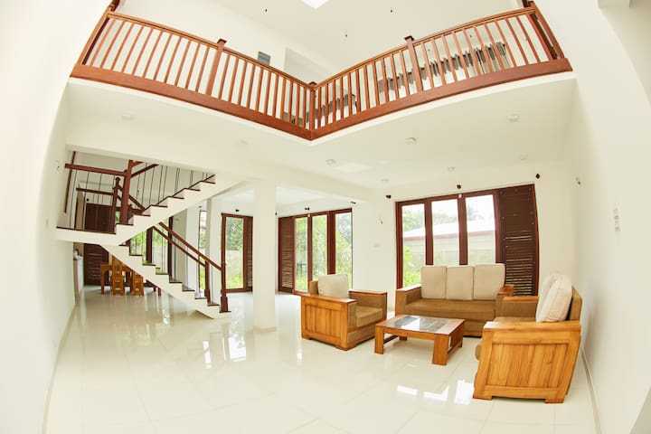 Home Stay Malabe with a living area and kitchen