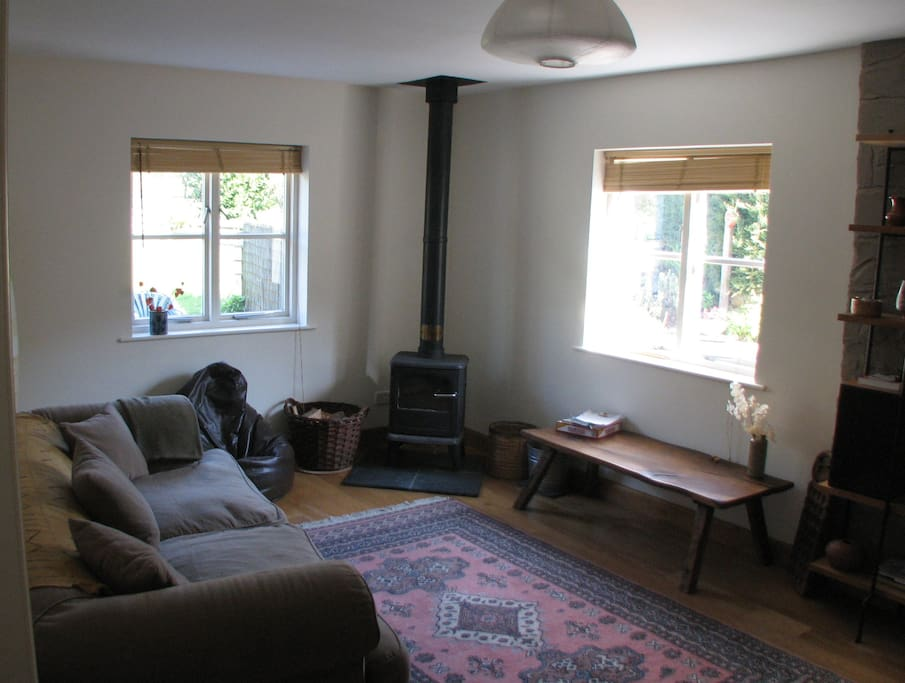 "second living area, the ""snug"" with wood burner and TV"