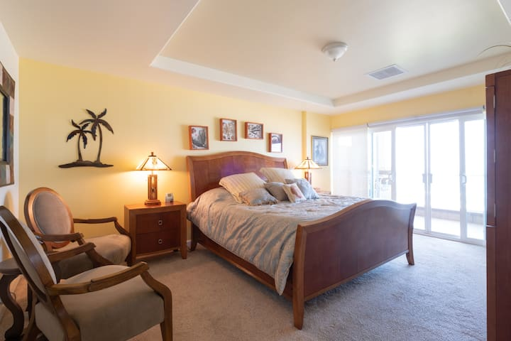 Master bedroom with ocean views. Relax and listen to the waves