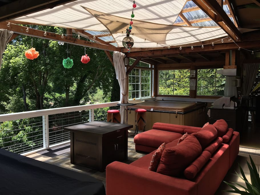 Private covered deck, hot tub, outdoor kitchen/BBQ, fire table, comfy couches, pool table, tv, and even a disco ball and lights!