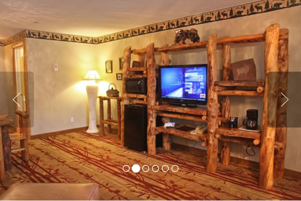 Gateway Honeymoon Suite  Designer Custom Aspen Log Entertainment Center