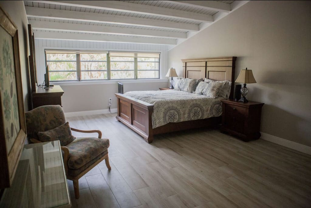 Large second floor master bedroom complete with king size bed and flat screen TV.