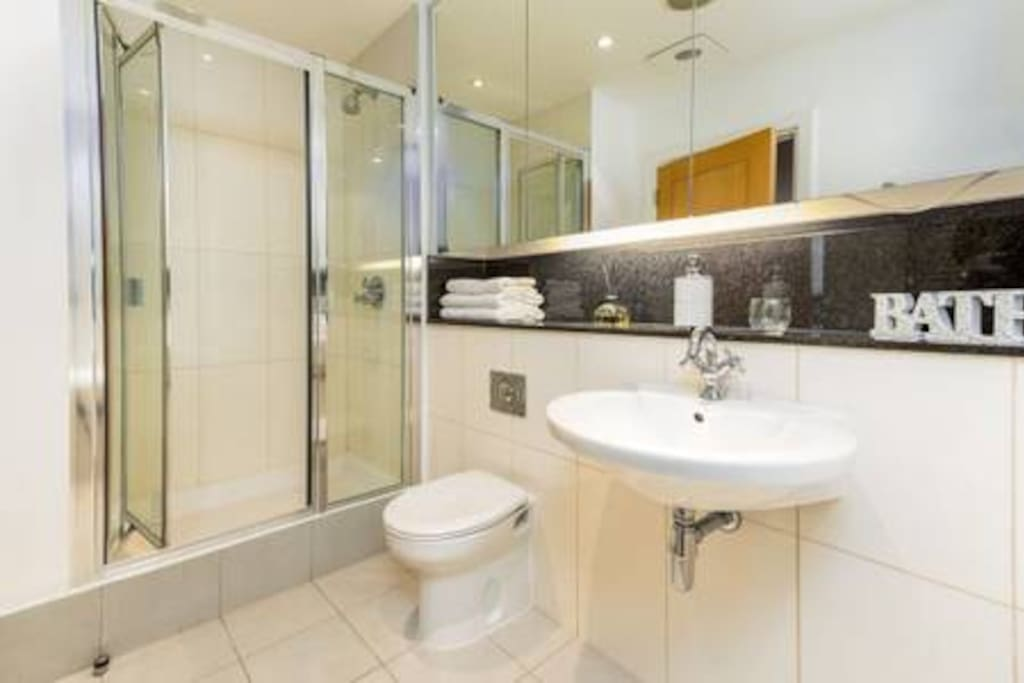 Your own private bathroom with bath and walk in shower.