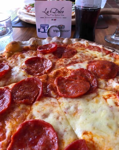 Just a 2 minute walk to the front of Las Palmas-enjoy unbelievable Pizza!