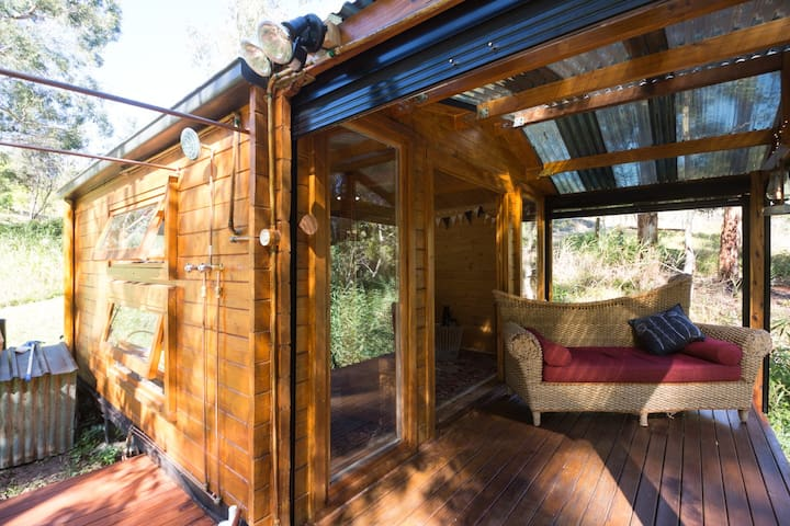 Shower on the deck with the koalas and birds,  or by starlight! Curtains are tucked away in kitchen drawer in case you prefer to use them :-)