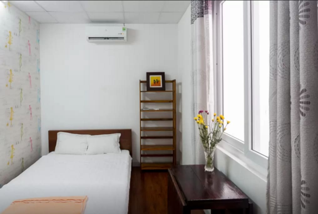Comfy room with a medium size bed and small attached bathroom