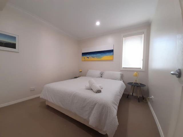 Bedroom 2 has a queen sized bed.