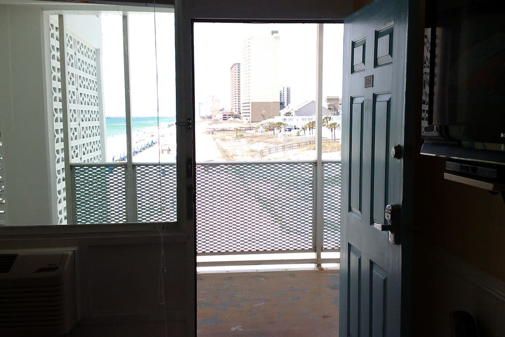 Looking out from the room to the Gulf and miles down the beach.