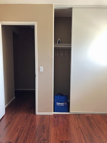 Roomy closet with hangers and iron