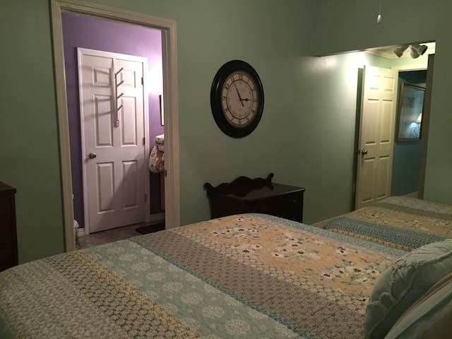 View from queen bed into your private  bathroom and also the  door  on the right that goes to the living room.