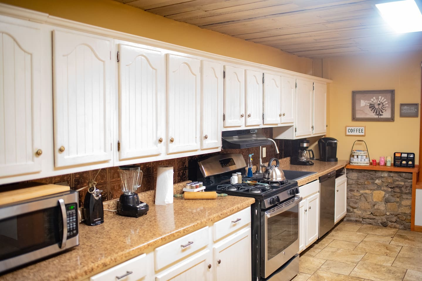 Kitchen - complete with tile warmers. Plenty of room to cook for a large family gathering. Grill is provided as well.