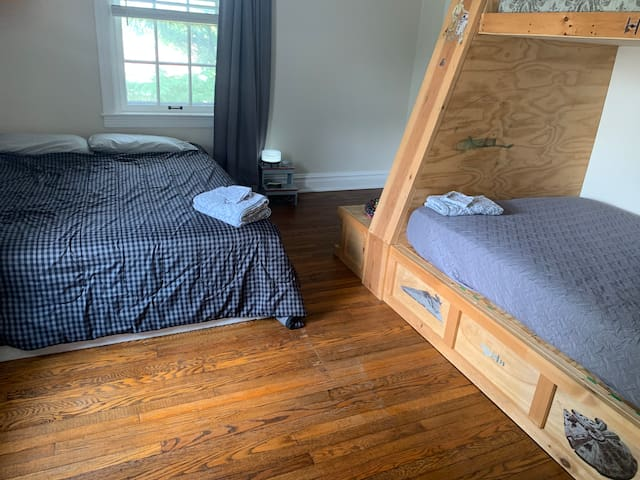 Queen bed in back bedroom with full bed.