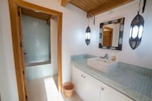Ensuite bathroom in guest house with bath and shower