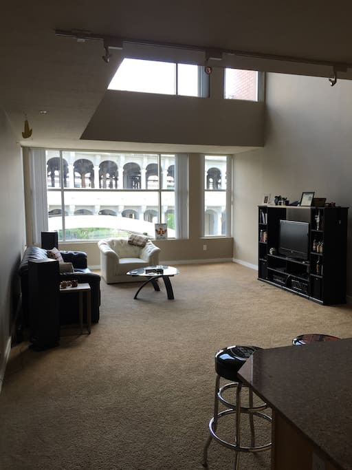 Bottom floor of penthouse with floor to ceiling windows overlooking Cuyahoga River