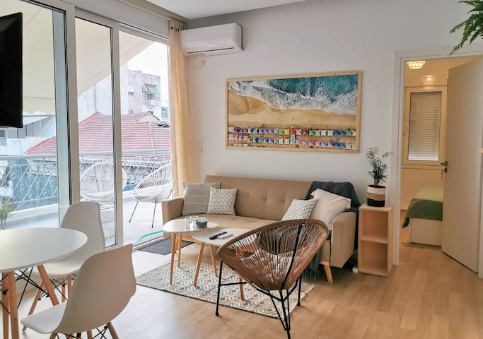 living room with panoramic window to the terrace