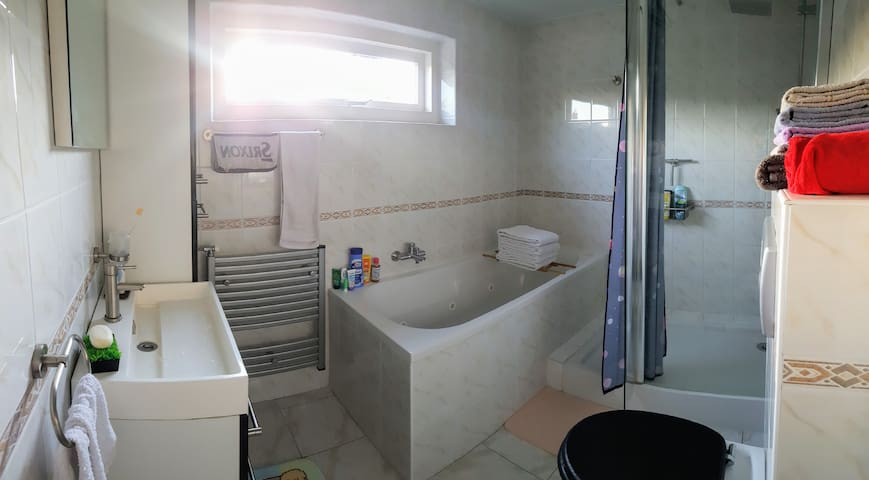 Bathroom with towels and hairdryer