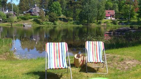 Mini villa su un terreno lacustre, spiaggia privata e pontile