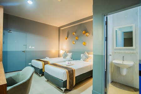 "Superior Twin Bed Room (26 sqm)  Twin Bed (3.5""), writing desk, wardrobe, air con, fridge, safe deposit box, microwave (lobby area), hot water boiler, rain shower, cable TV, bath room amenities balcony/terrace, plates & cutlery in room. Free Wifi"