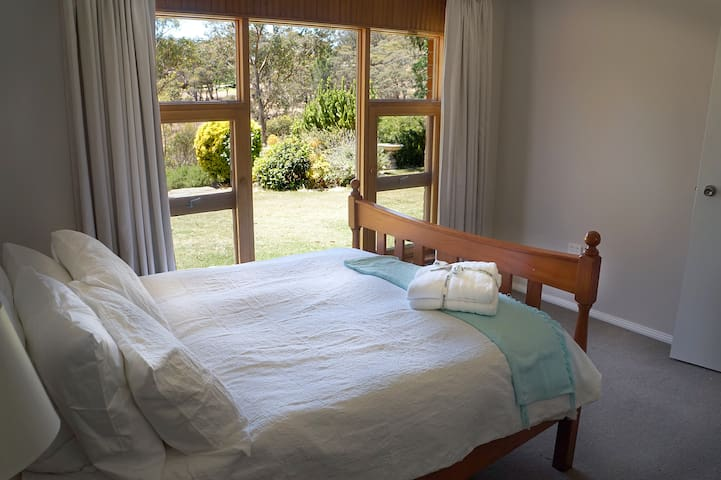 Your bedroom looks out into our garden and the hills beyond.