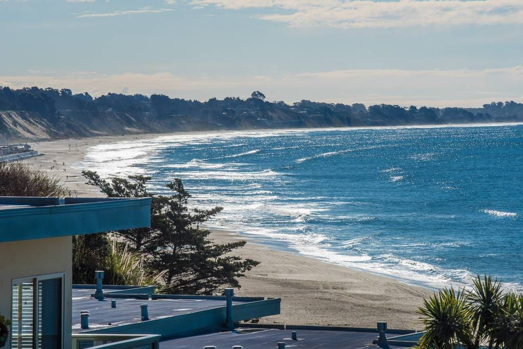 Cozy up on your amazing deck with a cup of coffee in the morning or a glass of wine or cocktails at sunset.  This is the view to the left off our balcony of New Brighton Beach views towards Monterey.