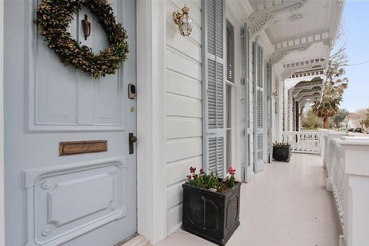 Beautiful front porch, perfect for enjoying morning coffee as the city wakes up. A stones throw from Audubon Park