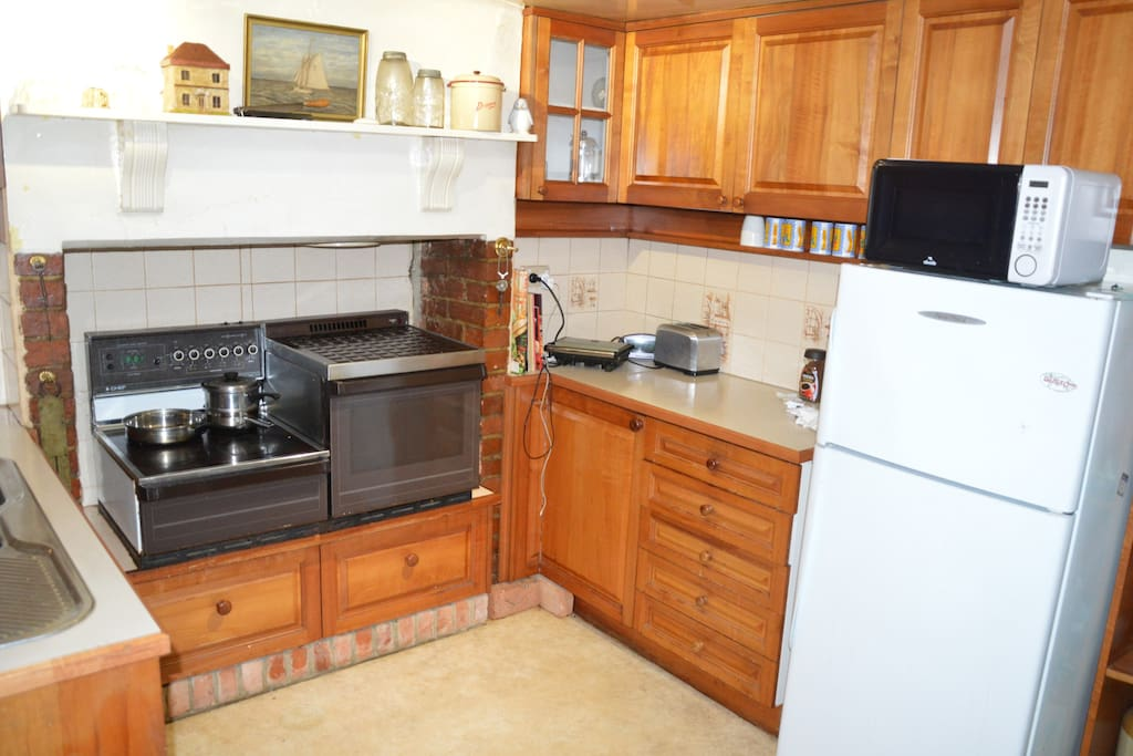 Kitchen is equipped with a large fridge, oven and microwave plus all the other essentials. A supply of coffee, tea, sugar and milk is provided.