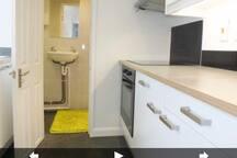 Kitchen and door to bathroom