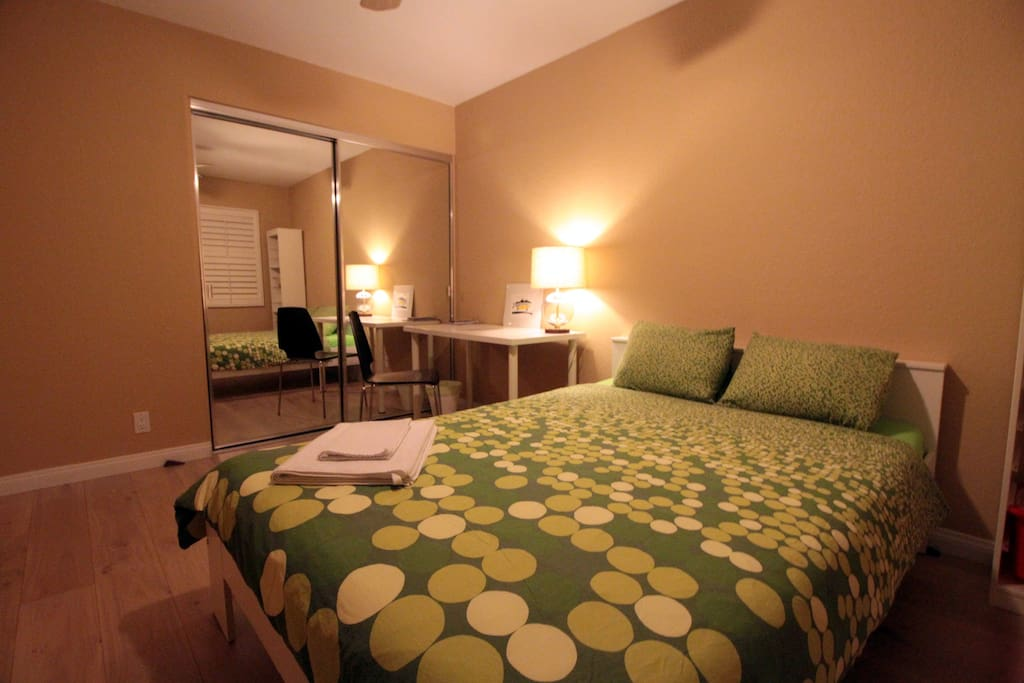 Guest bedroom sleeps two adults, with desk and chair