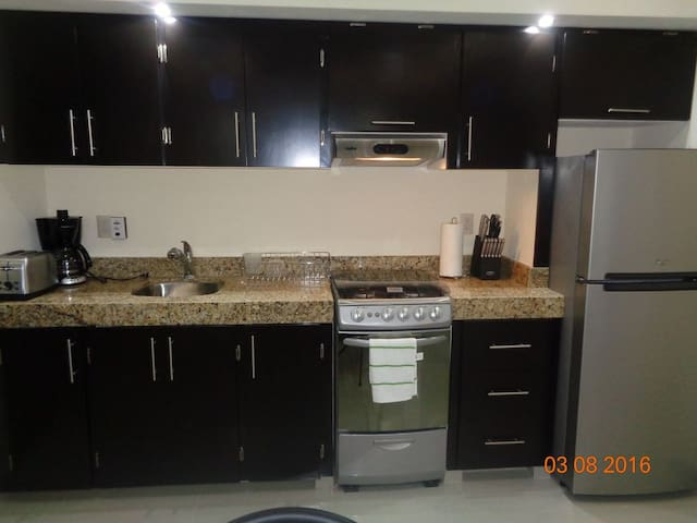 Granite kitchen fully equipped.