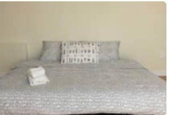 Queen bed in Designer District