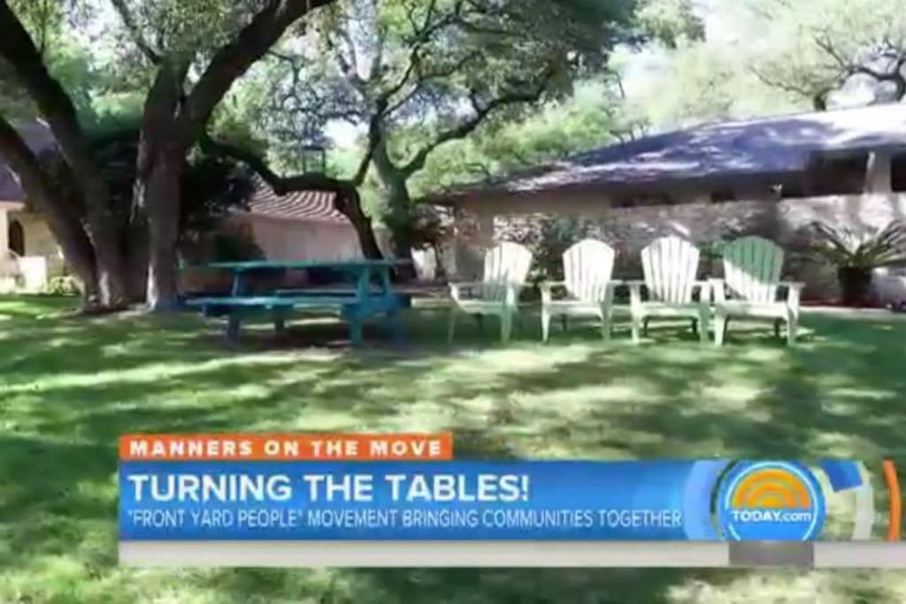 Front of house: As featured on the Today Show, we have a Turquoise Table and lawn chairs for easy outdoor entertaining on our shady, tree-lined street.