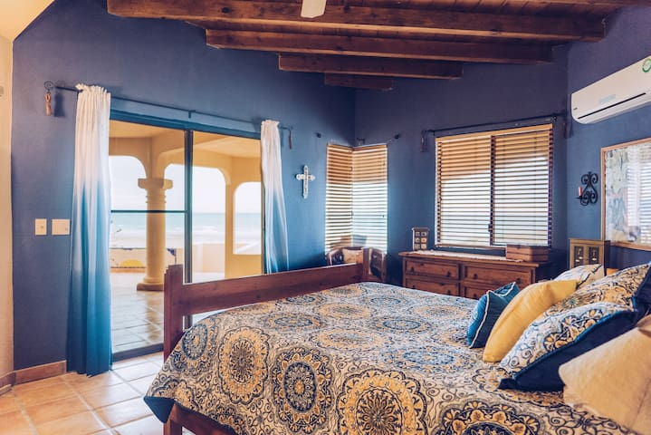 Bedroom #1 with incredible beach views and private access to patio