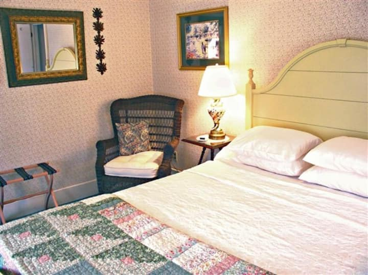 Queen Riverview with fireplace in historic bed and breakfast inn