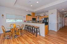 Open floor plan living, kitchen, and dining area